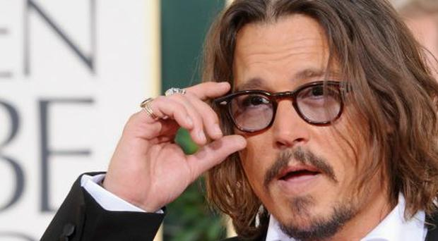 Actor Johnny Depp arrives at the 68th Annual Golden Globe Awards held at The Beverly Hilton hotel on January 16, 2011 in Beverly Hills