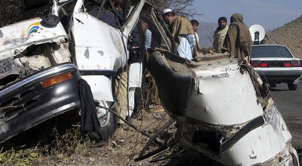 An explosion on a minibus in north-western Pakistan killed 18 people (AP)