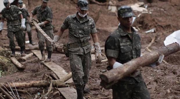 Soldiers remove debris from an area affected by landslides in Nova Friburgo, Brazil (AP)