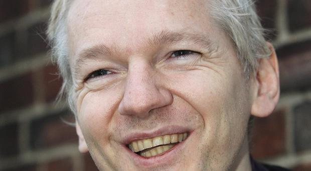 Julian Assange has received a disc containing confidential bank account details