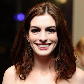 Anne Hathaway is a big fan of Glee