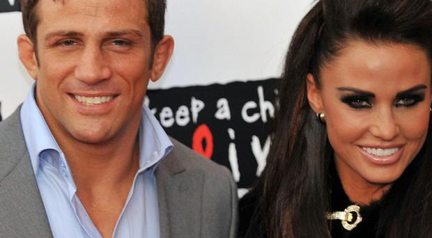 Cagefighter Alex Reid says he is 'in bits' over reported marriage problems with Katie Price