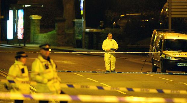 Police forensic officers at the scene in Dover, Kent