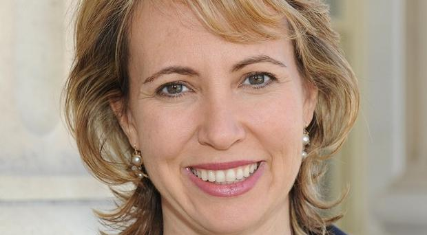 Gabrielle Giffords' husband says his wife's condition has improved (AP)