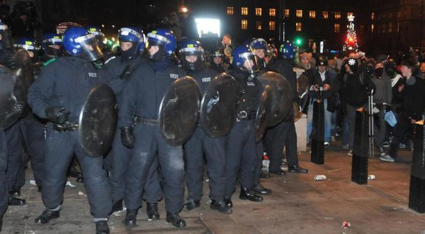 Police have bailed a man arrested as part of their inquiry into the student fee riots in London in December