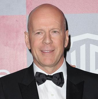 Bruce Willis has hinted he will be back for the Expendables sequel