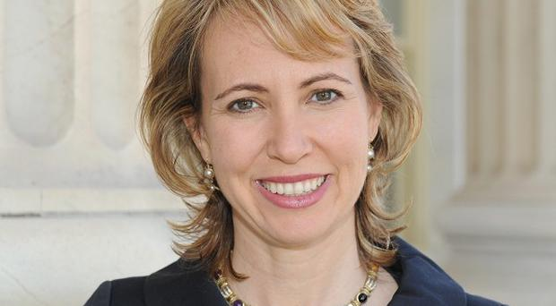 The husband of shot US politician Gabrielle Giffords thought she was dead after seeing a TV news report (AP)