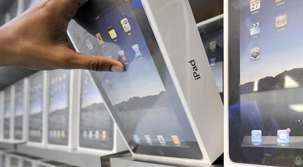Selling more iPads than expected helped Apple achieve record sales in the Christmas quarter