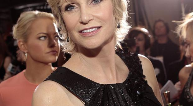 Jane Lynch reckons Simon Cowell can teach her character Sue Sylvester a thing or two