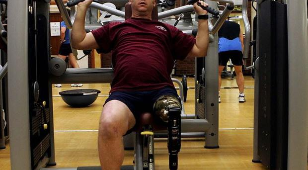 Paratrooper Sergeant Stuart Pearson, who lost a leg in a landmine explosion, has been awarded damages