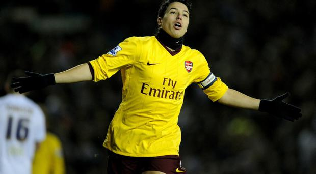 Samir Nasri of Arsenal celebrates scoring the opening goal during the FA Cup sponsored by E.On Third Round Replay match between Leeds United and Arsenal at Elland Road.