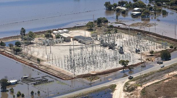 A levee is in place around a power substation in an attempt to hold back water from the swollen Lodden River at Kerang, Victoria