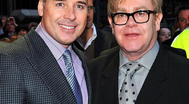 Elton John and partner David Furniss have pledged to continue their support for Ukrainian orphans