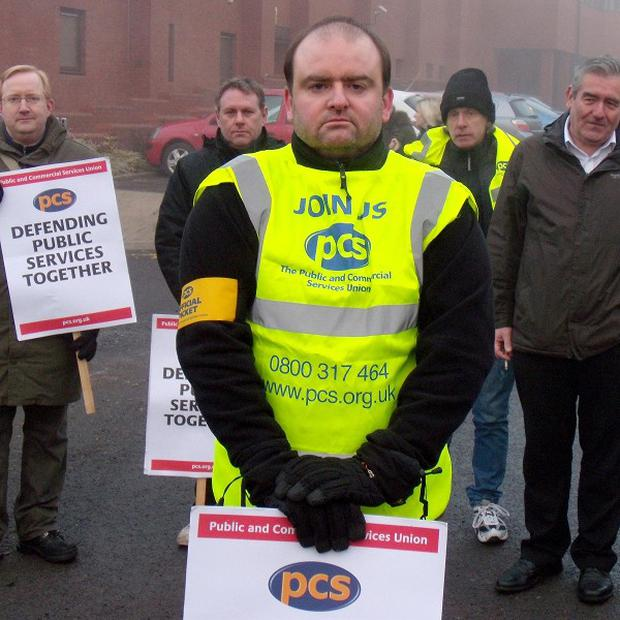 David Coventry, 40, and other PCS union representatives form a picket line in Glasgow