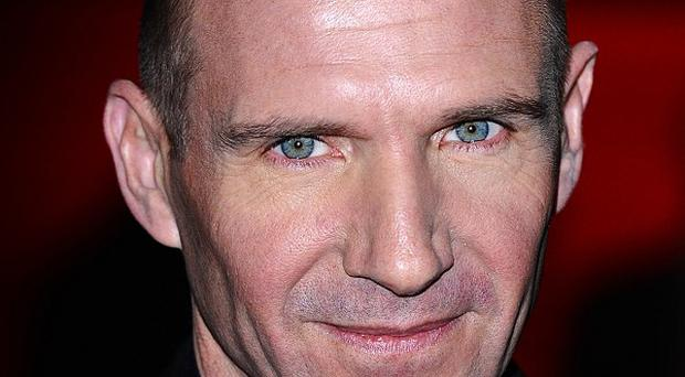Ralph Fiennes reckons a modern twist is the best way to go when portraying Shakespeare on the big screen
