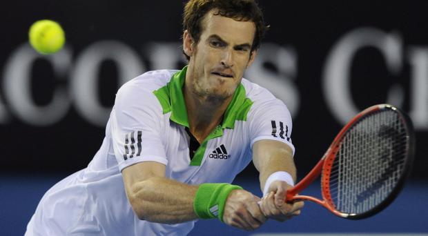Andy Murray plays a backhand return to Ukraine's Illya Marchenko during their second round match at the Australian Open tennis championships in Melbourne, Australia.