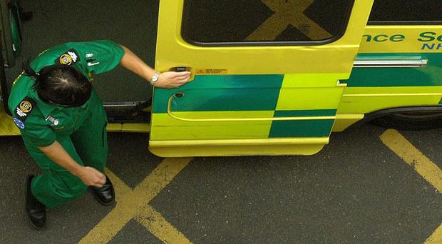 An ambulance carrying a seriously ill patient crashed on the way to hospital in Belfast