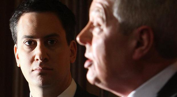 Alan Johnson, pictured with Labour leader Ed Miliband, has quit his role as shadow chancellor