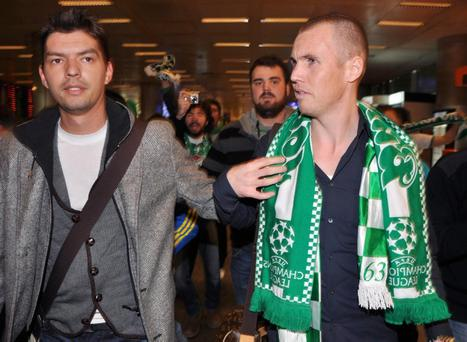 Former Glasgow Rangers player Kenny Miller, is seen with supporters of his new club Bursaspor at the Bursa airport, Turkey, late Wednesday, Jan. 19, 2011.