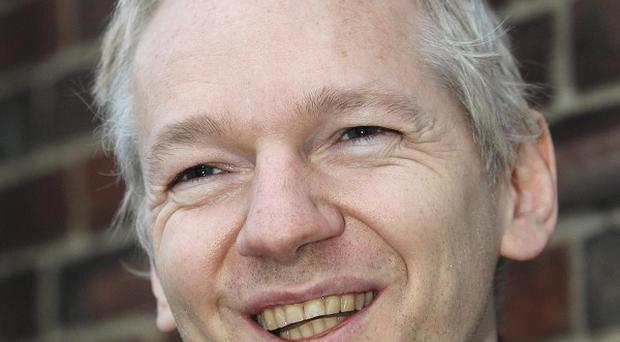 Sweden's prime minister has insisted his government will play no role in deciding whether WikiLeaks founder Julian Assange should be extradited