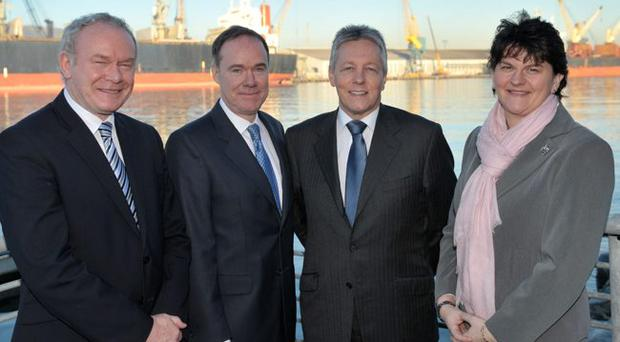 Deputy First Minister Martin McGuinness, Fidessa chief executive Chris Aspinwall, First Minister Peter Robinson and Enterprise Minister Arlene Foster at the announcement of an expansion of Fidessa's operation in Belfast, which will create 90 new jobs