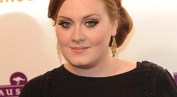 Adele says she's grown up a lot in the past three years