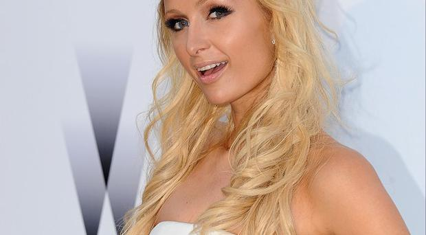 Paris Hilton's boyfriend Cy Waits has been charged with driving under the influence of marijuana