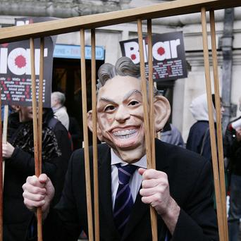 A protester in a Tony Blair mask outside the Chilcot Inquiry venue