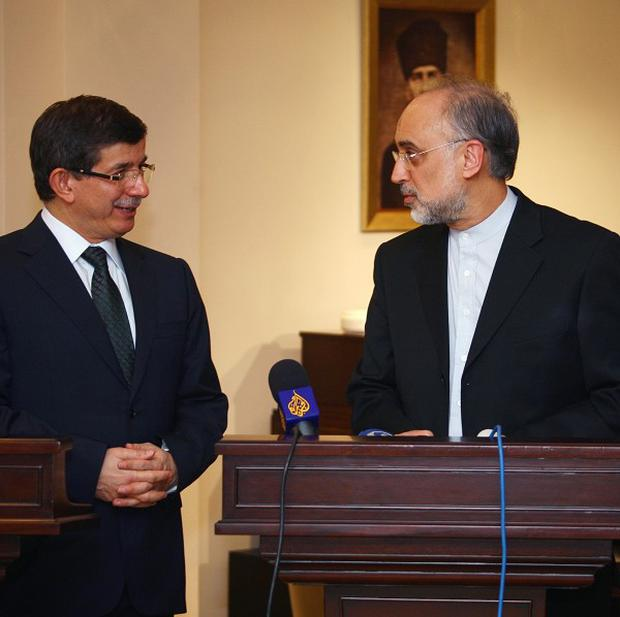 Turkish foreign minister Ahmet Davutoglu, left, and his Iranian counterpart Ali Akbar Salehi speak to the media in Ankara, Turkey (AP)