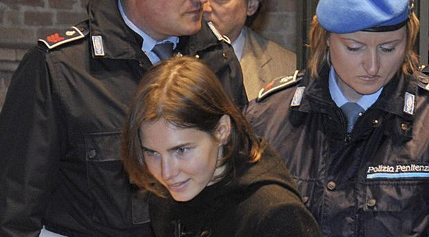 Amanda Knox arriving in court for the latest hearing in her appeal against her conviction for murdering British student Meredith Kercher (AP)