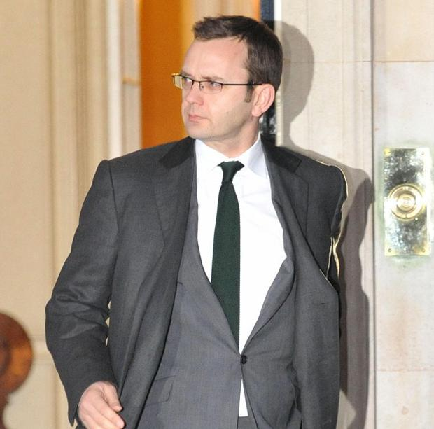 Andy Coulson leaves 10 Downing Street after resigning as David Cameron's communications director