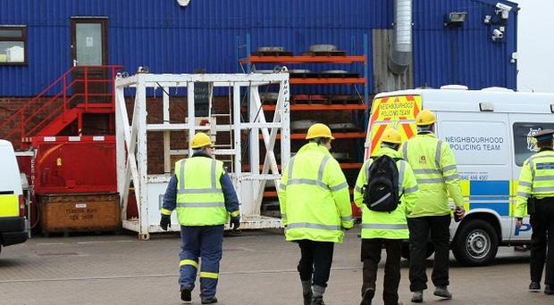 Members of the Health and Safety Executive enter offshore Engineering firm in Great Yarmouth after four workmen died