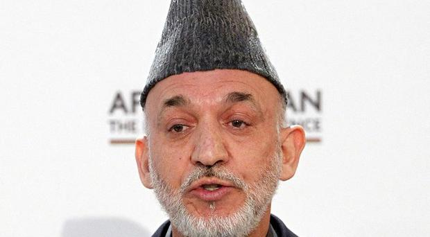 Afghan President Hamid Karzai has agreed to scrap a one-month delay in convening the new parliament