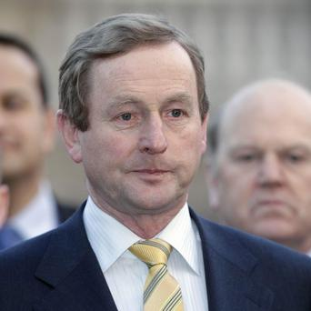 Fine Gael Leader Enda Kenny warned he could move a motion of no confidence in Mr Cowen as Taoiseach