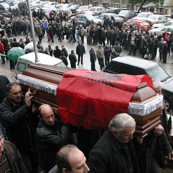 Relatives carry the coffin of Ziver Veizi during his funeral in southern Gjirokastra, Albania
