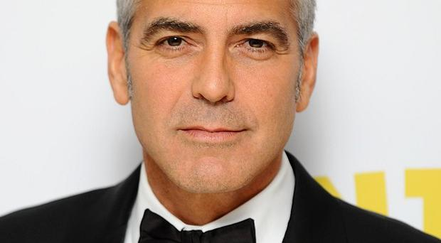 George Clooney is to describe his battles with malaria after trips to Africa