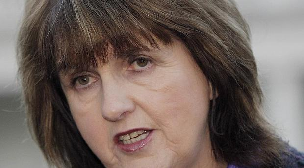 Labour's Joan Burton has put forward a 34-hour timetable to get the Finance Bill into law by Friday night