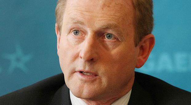 Fine Gael leader Enda Kenny has vowed to confront the threat of dissidents on both sides of the border