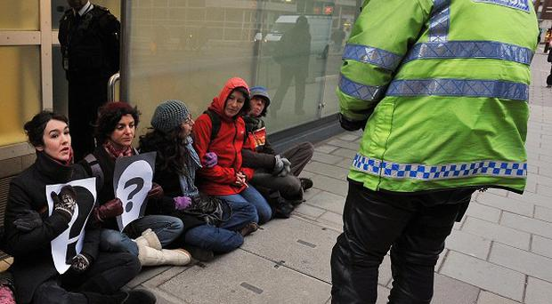 Protesters blockade New Scotland Yard, London, as they called for a judge-led inquiry into the use of undercover policing