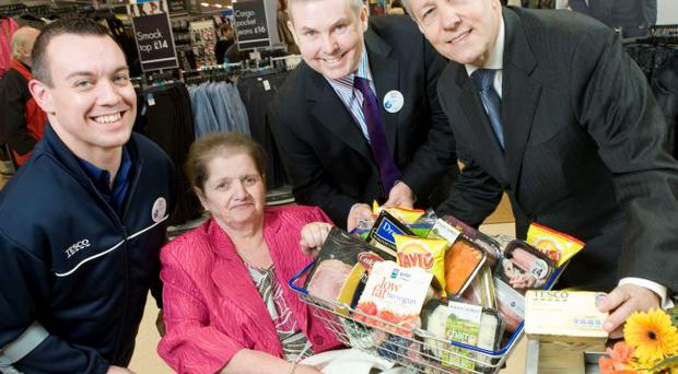 Andy White, Community Champion Tesco Extra, Lilian Percival, local shopper nominated to open the new store, Tony O'Neil, Store Manager and First Minister Right Honourable Peter Robinson MLA 'check out' the local produce at the new Tesco Extra store, Craigavon where 183 new jobs have been announced