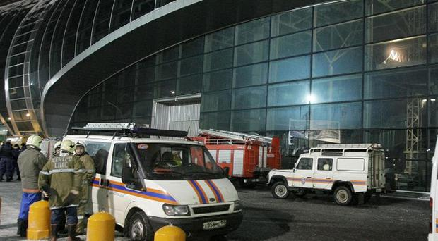 Fire engine and emergency vehicles are seen outside Domodedovo airport, Moscow (AP)