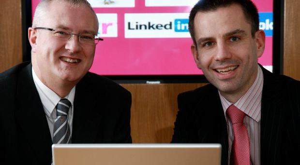 Mervyn Langtry (left) of the Department for Employment and Learning, with speaker Gareth Dunlop, managing director of iON