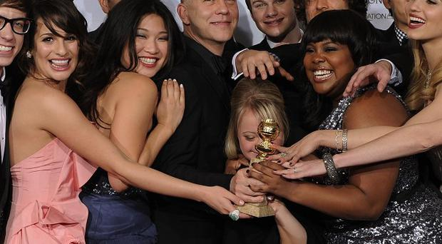 The cast of Glee celebrate success at the Golden Globes