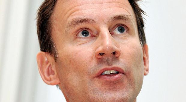 Culture Secretary Jeremy Hunt plans to refer News Corporation's bid for full control of BSkyB to the Competition Commission