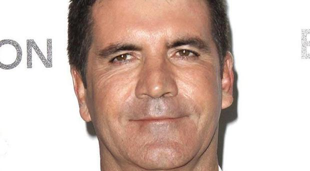 Simon Cowell has lent his support to a Save The Children campaign