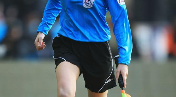 Female assistant referee Sian Massey in action during the Barclays Premier League match between Wolverhampton Wanderers and Liverpool