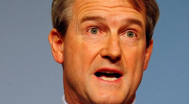 Owen Paterson has urged ministers to accept plans to let Stormont set its own corporation tax levels