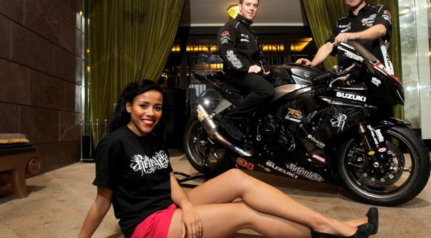 Relentless Energy drink press launch for the 2011 Relentless International North West 200 thats due to take place on 21 May. Relentless Suzuki riders Alistair Seeley and Guy Martin pose with Miss Northern Ireland Lori Moore.