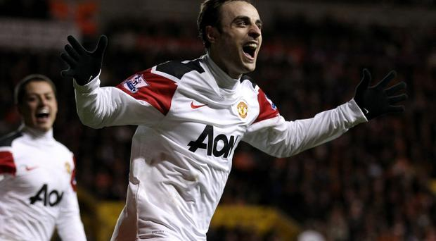 Dimitar Berbatov of Manchester United celebrates scoring his team's third goal during the Barclays Premier League match between Blackpool and Manchester United at Bloomfield Road on January 25, 2011 in Blackpool, England.