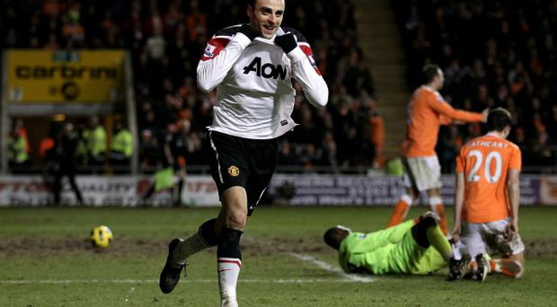 Dimitar Berbatov of Manchester United celebrates scoring during the Barclays Premier League match between Blackpool and Manchester United at Bloomfield Road on January 25, 2011 in Blackpool, England.